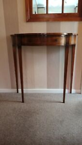 Antique, elegant Demi-Lune hall table. Walnut top; fluted tapered legs