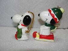 2 Ceramic Peanuts Japan Snoopy Ornaments w Wreath & Sled