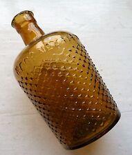 Medium size light amber hatched lysol poison/disinfectant bottle C 1915