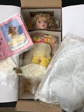 Paradise Galleries New In Box porcelain doll Genevieve Kissed by an Angel