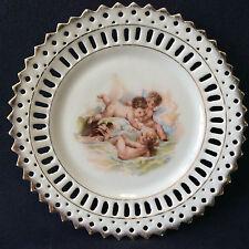Assiette en porcelaine ajourée décor putti anges dorure anonyme fin XIX ème ,