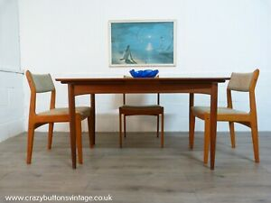 Danish teak extending dining table and 4 Bramin chairs.