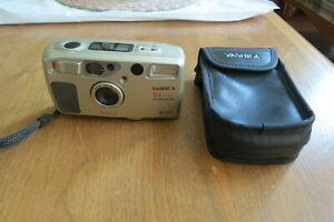 Yashica T4 Super Weatherproof camera w/case. Carl Zeiss Lens. Nice working cond.