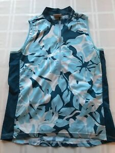 CANNONDALE SLEEVELESS CYCLING TOP 1/2 ZIP-WOMENS MEDIUM BLUE FLORAL TS9
