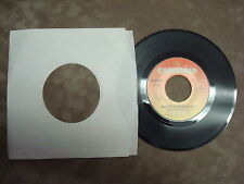 BARBRA STREISAND- RUN WILD/ WOMAN IN LOVE  45 RPM