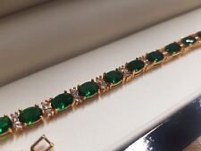 Yellow gold finish oval Green emerald and created diamonds tennis bracelet