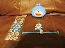Doraemon 4 Piece Lot (Stickers, Keychain, Purse and Bracelet)  (NEW)