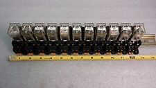 Omron   11 Relays IEC255 w/ Sockets 2230HP on a Rail.  Set sold as one unit.