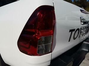 TOYOTA HILUX LEFT TAILLIGHT UTE, OK-37, 09/15-06/20 GENUINE WITH A FEW LIGHT SCR