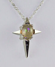 Stunning Star Cross with 8X6 mm Oval 1.55 ct Ethiopian Opal Sterling Silver