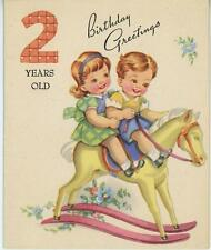 VINTAGE CUTE BOY GIRL RIDING TOY ROCKING HORSE 2 YEARS OLD BIRTHDAY CARD PRINT