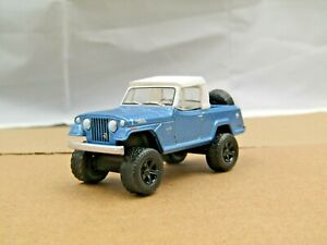 dcp/greenlight Custom lifted blue/white Jeepster 4x4 1/64.