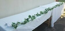 Extra long top table ivory wedding flower arrangement fairy lights, garland/arch