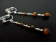 A PAIR TIBETAN SILVER TIGERS EYE  BEAD  EXTRA LONG CLIP ON  EARRINGS. NEW.