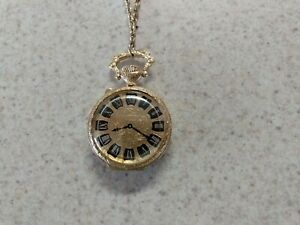 Vintage  Estee Lauder Necklace with Clock Face  Perfume compact. Gold tone.