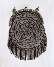 Antique black and silver beaded purse with metal frame and fringe