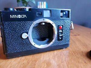 AS-IS Minolta CLE 35mm Rangefinder Body and matching Flash Film Camera
