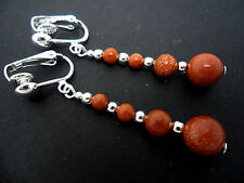 A PAIR OF BROWN GOLDSTONE  SILVER PLATED DROP DANGLY CLIP ON  EARRINGS. NEW.