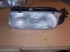 1991 - 1996 ROADMASTER ESTATE WAGON LEFT HEADLIGHT & BRACKET OEM USED HAS WEAR