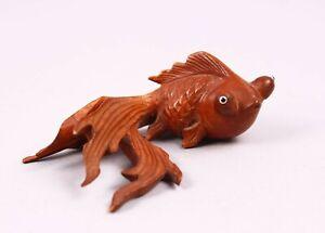 A fine Vintage Chinese boxwood goldfishwith inset glass eyes