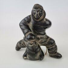 More details for vintage inuit eskimo stone carving hunter and seal ultra violet markings to base