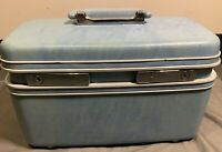 Vintage Samsonite Light Blue Train hard Case luggage silhoutte