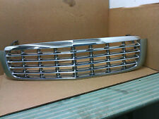 1997 - 1999  Cadillac Deville  chrome grille with Champagne surround  OEM