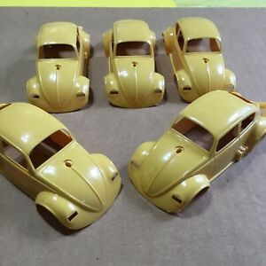 VINTAGE FIVE PIECE GROUPING VOLKSWAGEN BODY SHELL / YELLOW / NEW OLD STOCK!!!!!