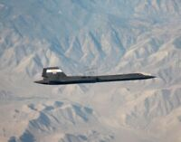 SR-71A in Flight View from Tanker during an Airborne Refueling 12X18 Photograph