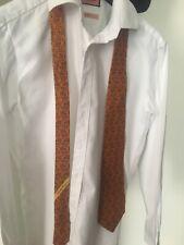 Salavtore Ferragamo silk tie in classy orange colour with bird pattern