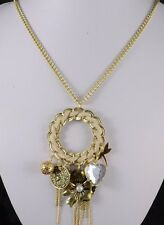 GOLD TONE LONG CHAIN  NECKLACE WITH DROP ROUND SHAPE WITH SMALL 7 CHARMS