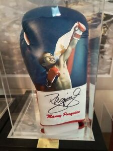 Manny pacquiao signed glove in glass case with Certificate Of Authentication.