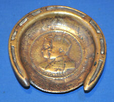 A rare King George V, Queen Mary pin or coin dish, horseshoe, brass, repousse