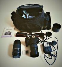 Canon EOS 1000D 10.1 MP Digital SLR Camera plus 2 lenses (35-80mm) & (75-300mm)