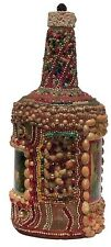A well constructed memory bottle decorated with multicolor beads, shells - more.