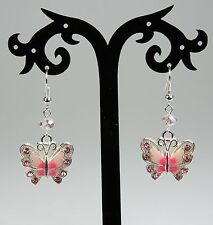 Pink enameled butterfly earrings with rhinestones, pink crystals, silver hooks