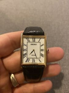 Seiko Solar Mens Tank Style Black Leather Gold Tone Dress Watch SUP880