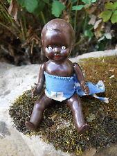 Ancienne petite poupée noire en celluloïd