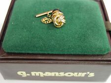 Elegant knotted gold tie tack