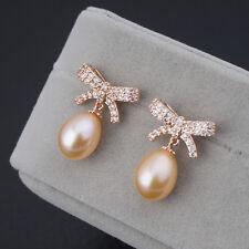 Boucles d`Oreilles Perle de Culture Rose Argent Sterling 925 Noeud Doré Vif