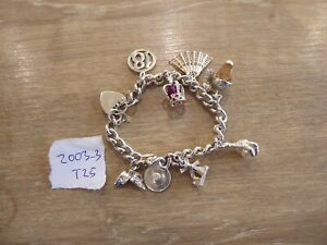 BEAUTIFUL VINTAGE SOLID SILVER CHARM BRACELET WITH 9 CHARMS