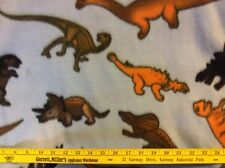 """dinosaurs on light blue ackground fleece fabric 60"""" wide, sold BTY"""
