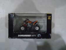 1.32 BOMBARDIER ATV DIECAST IN THE BOX.  MADE BY NEW RAY MODELS