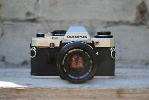 Olympus OM10 35mm Film Camera with 50mm f1.8 Zuiko Lens and Olympus Case