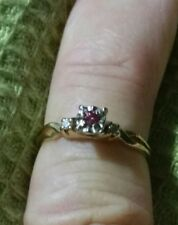 .20ct. Pink Diamond with 2 side natural white diamonds graded VS H in 14KT. gold