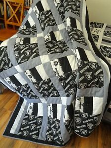 Full/twin size football quilt. Measures 80 by 65 inches,with a gray cott