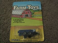 VINTAGE ERTL FARM TOYS BLUE AND WHITE MANURE SPREADER 1/64 1986 NEW IN PACKAGE