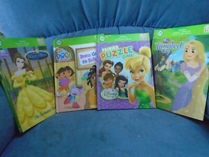 LOT OF 4 LEAP FROG TAG BOOKS DISNEY FAIRIES PUZZLE TIME, TANGLED, DORA, BEAUTY