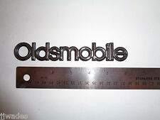 """NOS OLDS OLDSMOBILE PLASTIC EMBLEM 1"""" TALL X 6"""" LONG WITH SELF ADHESIVE BACKING"""