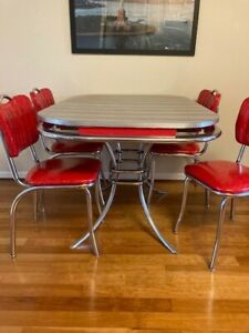 Retro diner table authentic 1953 with matching chairs.